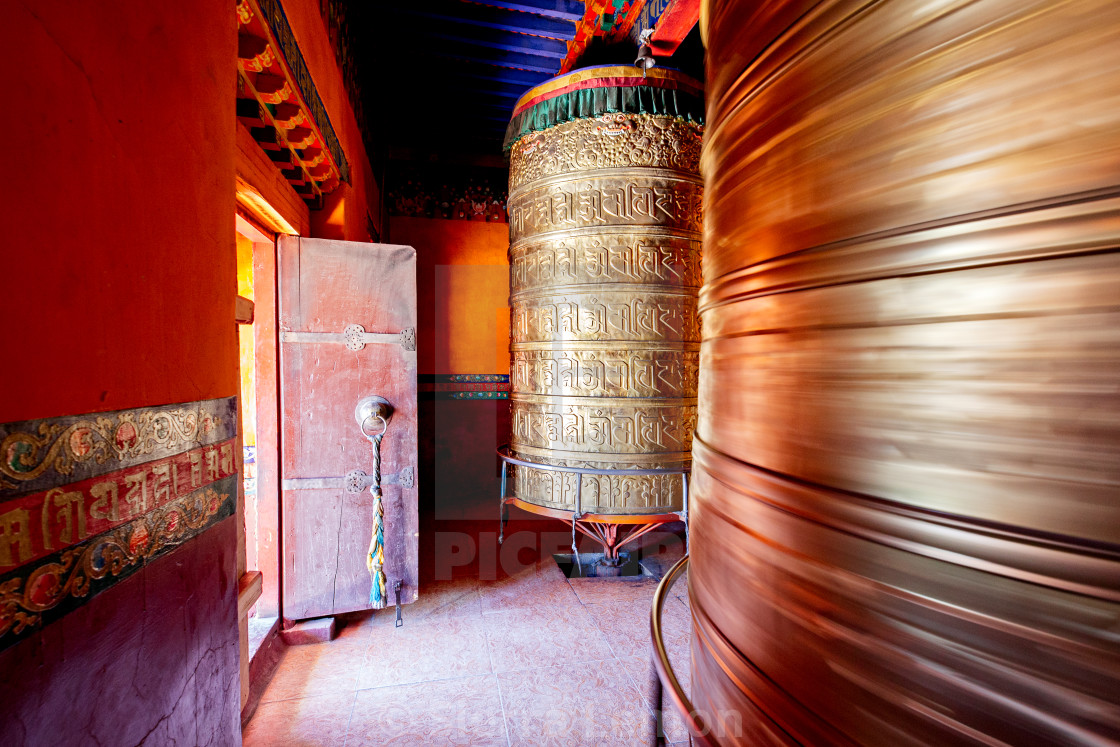 """Prayer Wheels at Phuntsoling Monastery, Tibet, China"" stock image"