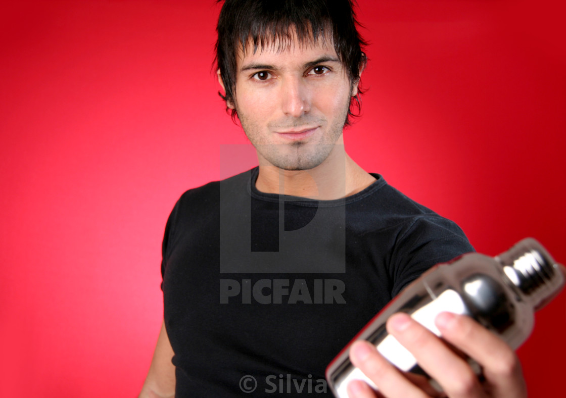 """""""Young bartender shaking a drink"""" stock image"""