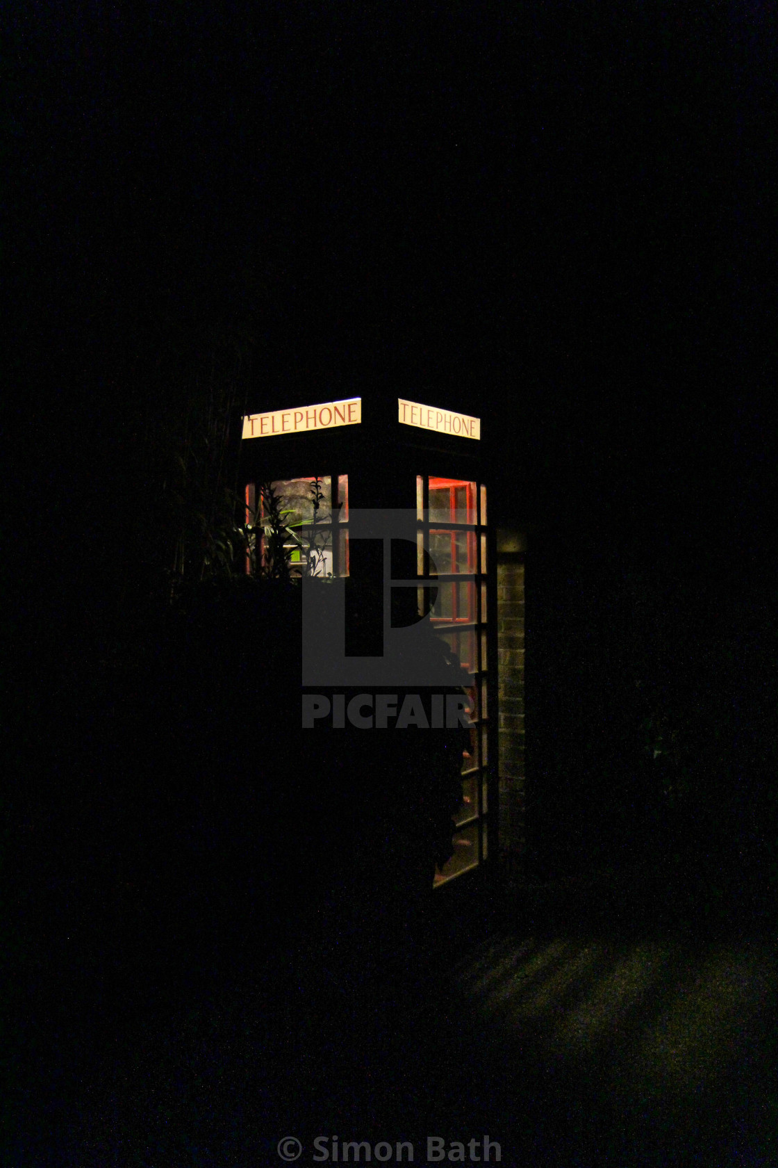 """Red Telephone Box in the Night"" stock image"