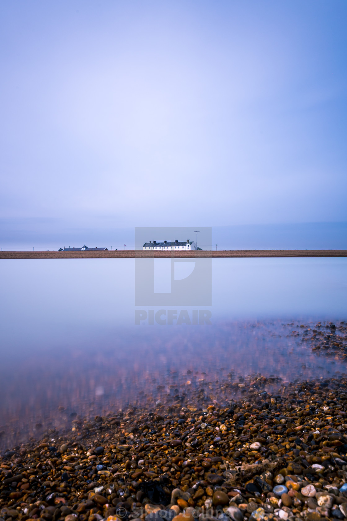 """A long exposure of the clouds and water at Shingle Street in Suffolk"" stock image"