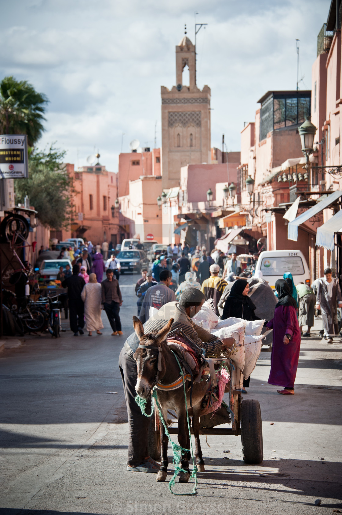 """18-04-11. Marrakech, Morocco. Pedestrians, cars and donkeys share the road..."" stock image"