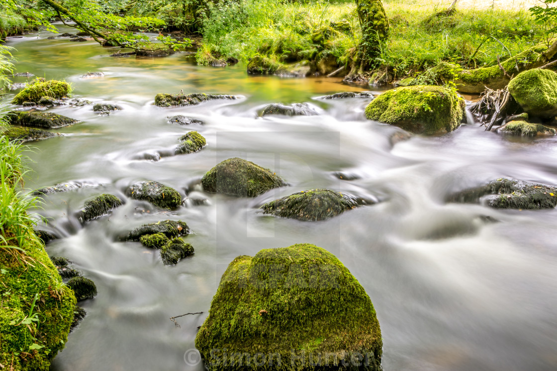 """River Rapids at Golitha Falls"" stock image"