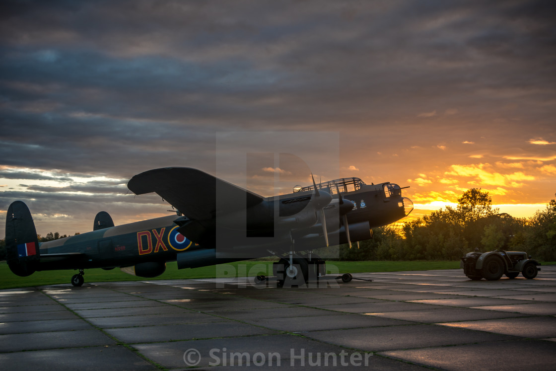 """Lancaster and tractor at sunset"" stock image"