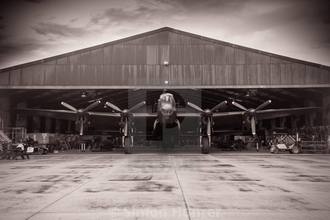 """""""Lancaster bomber leaving the hangar"""" stock image"""