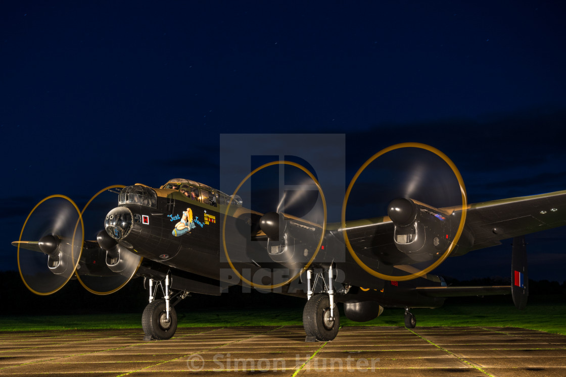 """Lancaster bomber with propellers running"" stock image"