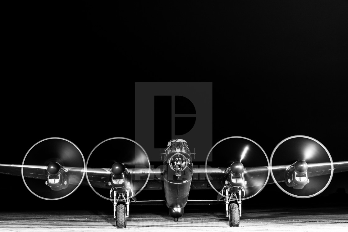 """Black and White shot of the Lancaster bomber with engines running"" stock image"