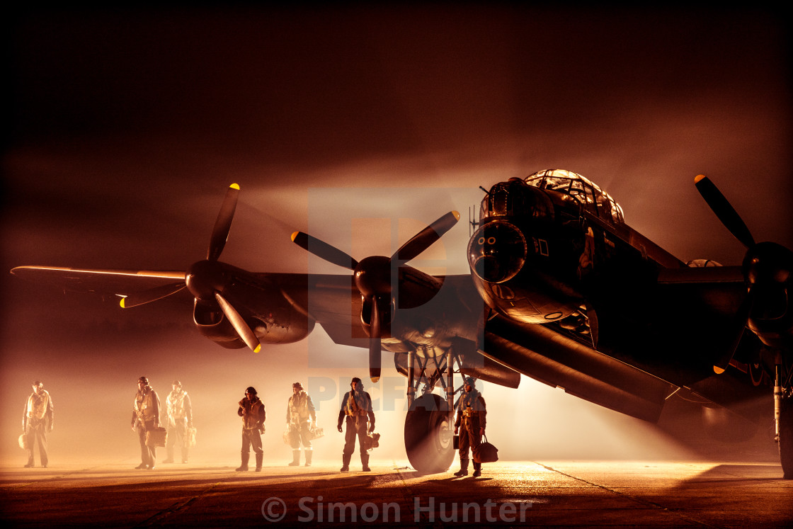 """Another atmospheric picture of Lancaster bomber and crew"" stock image"