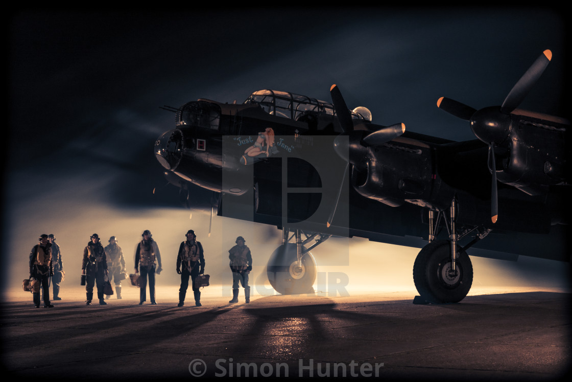 """Lancaster bomber and crew at night"" stock image"