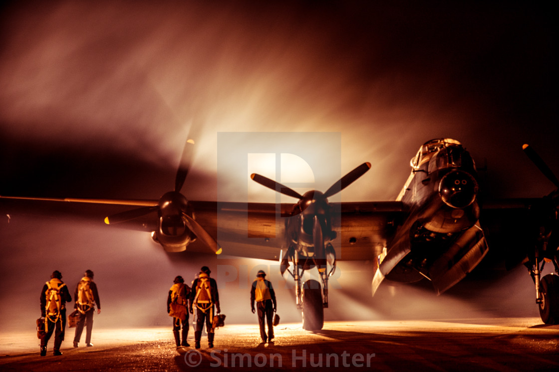 """Atmospheric picture of Lancaster bomber and crew"" stock image"
