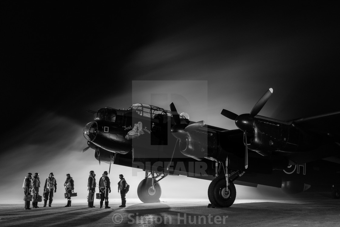 """Lancaster bomber with crew in black and white"" stock image"