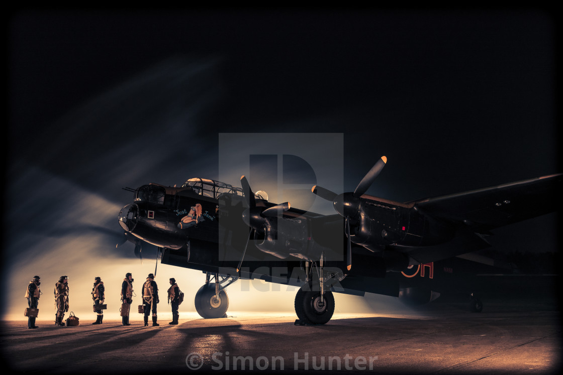 """Lancaster bomber with crew at night"" stock image"