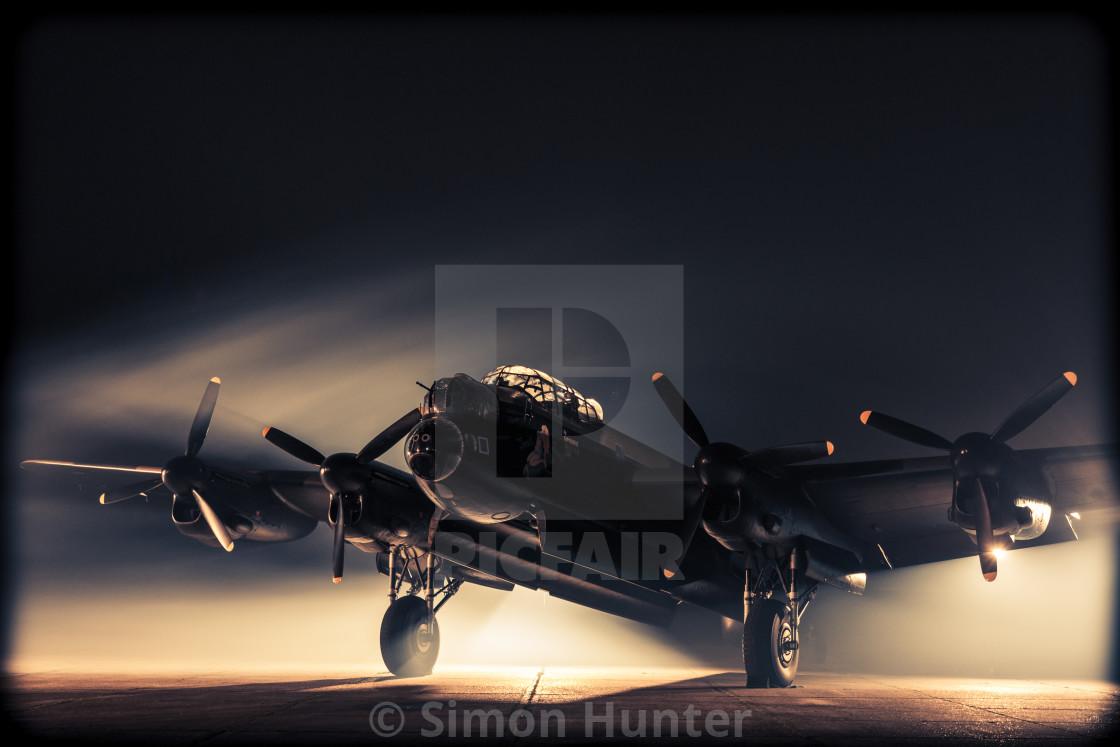 """Misty shot of a Lancaster bomber"" stock image"