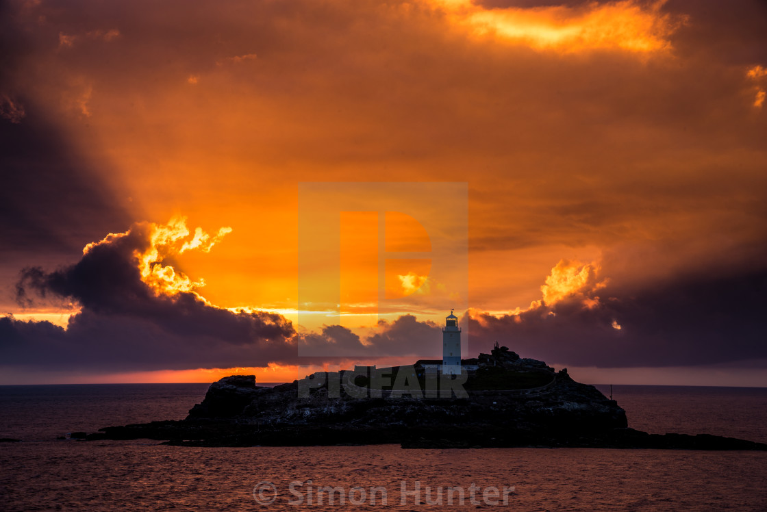 """Sunsetting at Godrevy Lighthouse"" stock image"