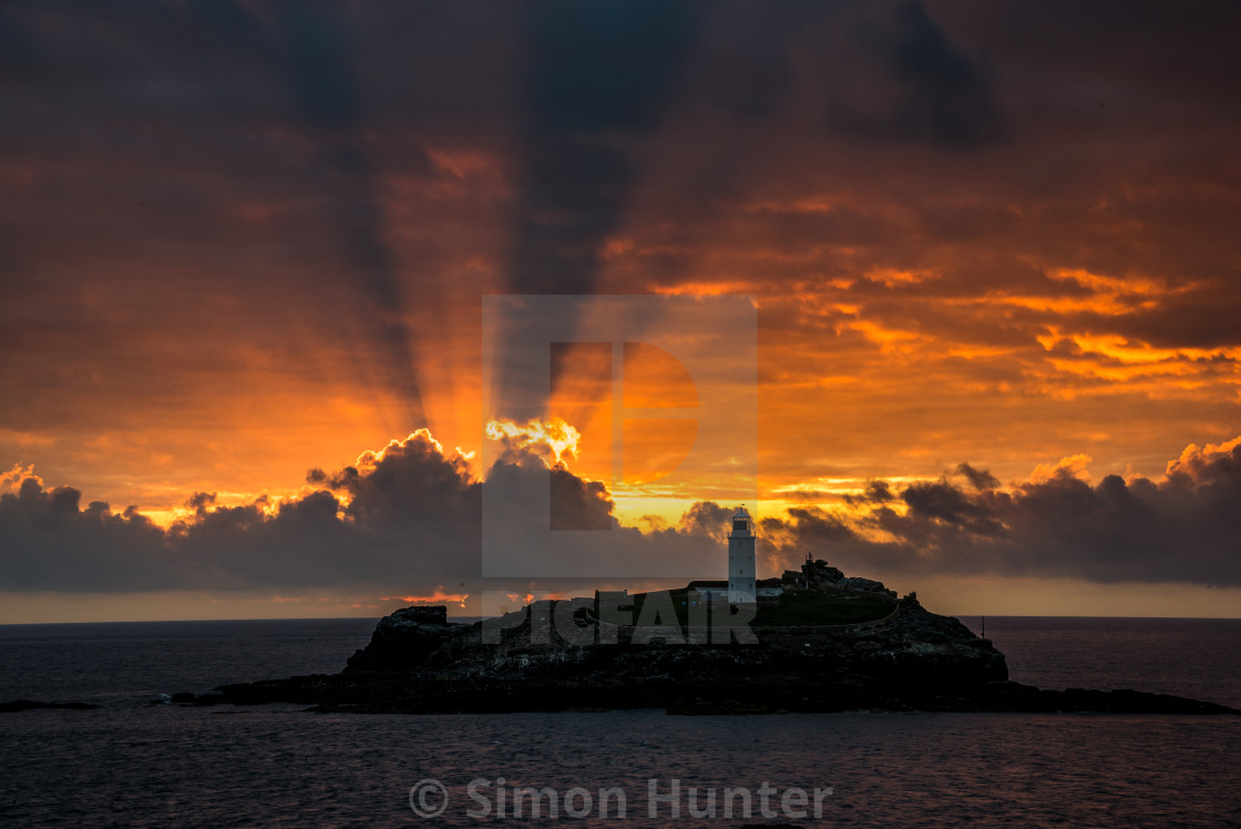 """Amazing dramatic sunset at Godrevy"" stock image"