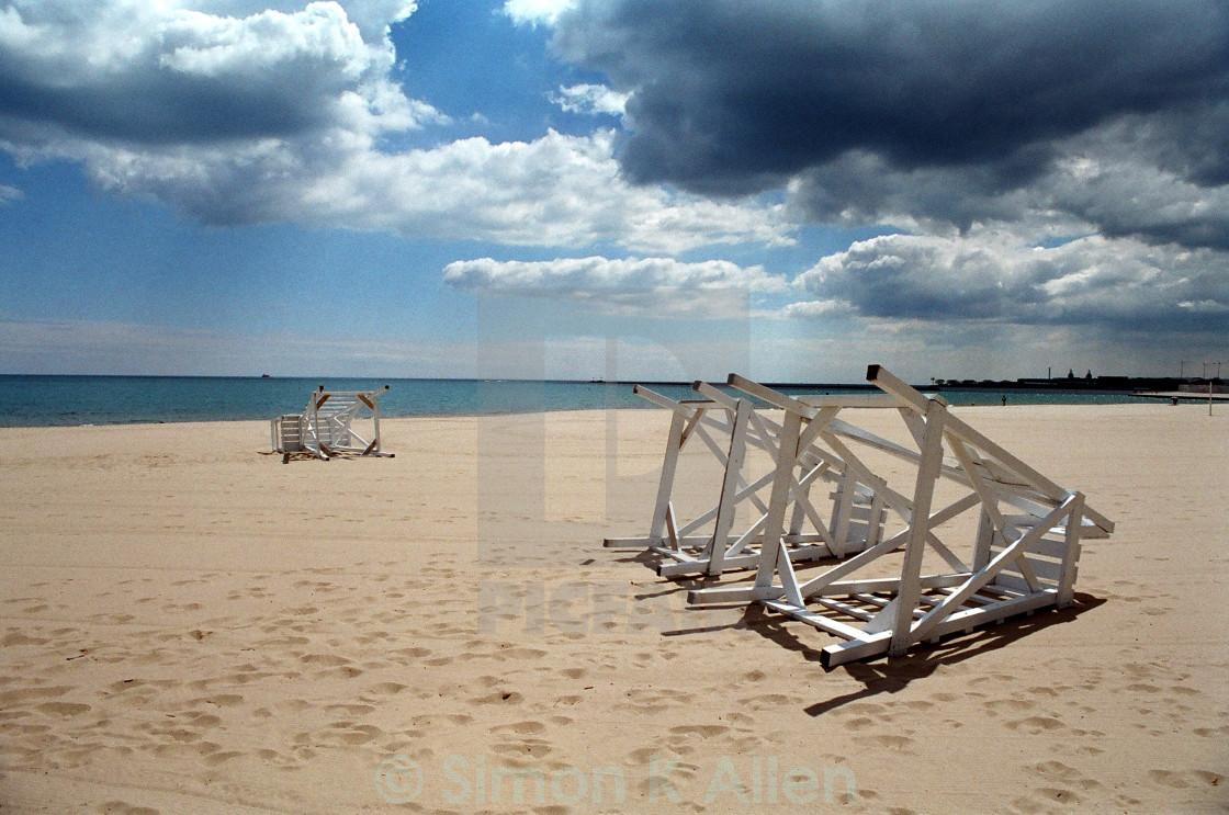 """Overturned Lifeguard Chairs"" stock image"