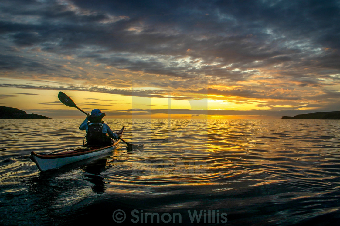 """Sea kayak sunset"" stock image"