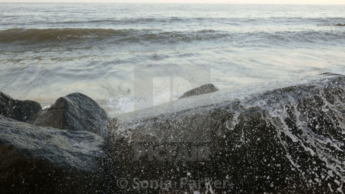"""Crashing Waves Over Sea Wall"" stock image"