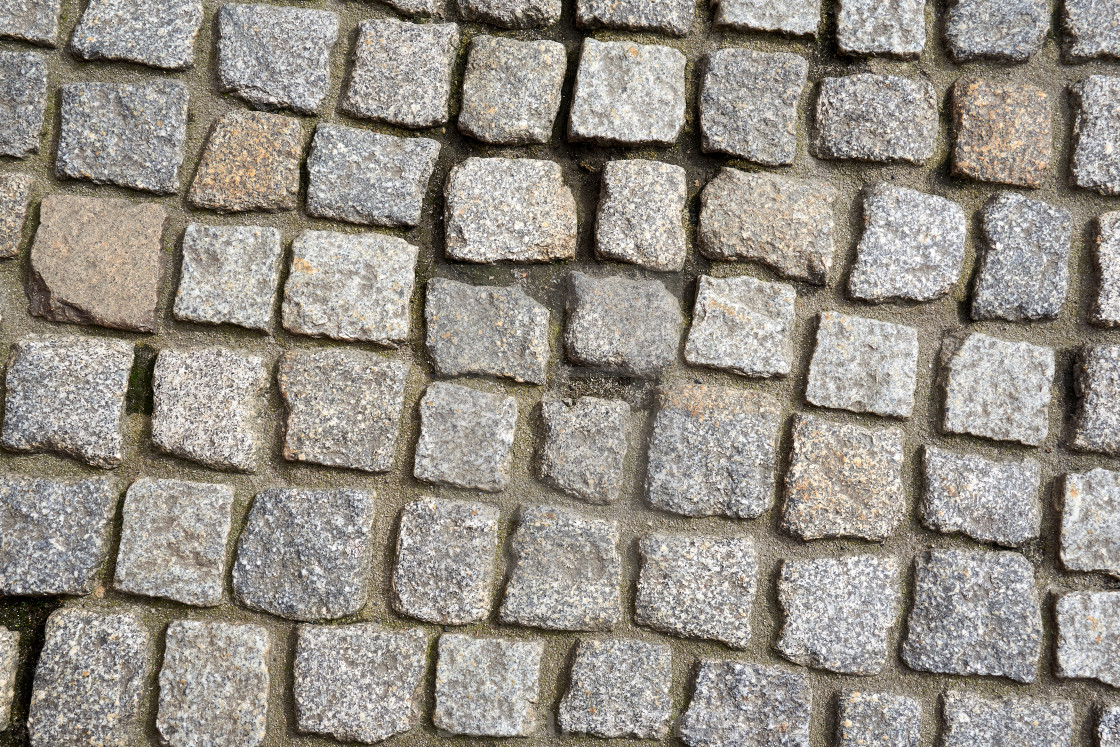 """cobblestones on the ground of a city avenue"" stock image"