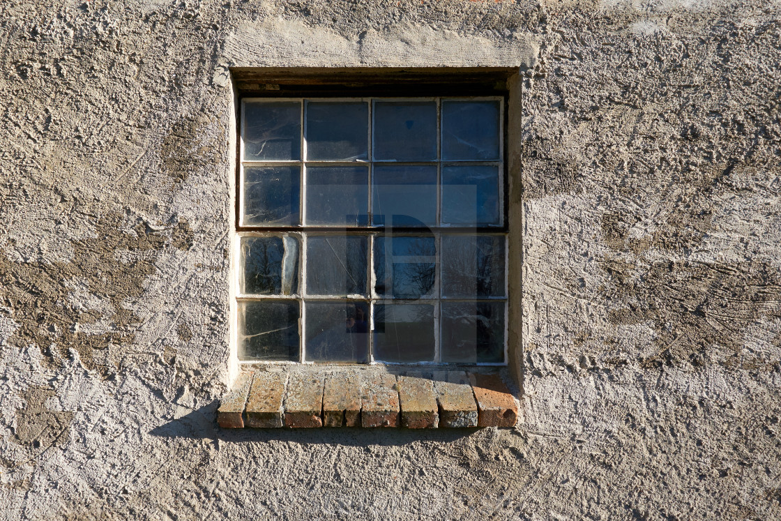 """window in cracked and weathered wall outside"" stock image"