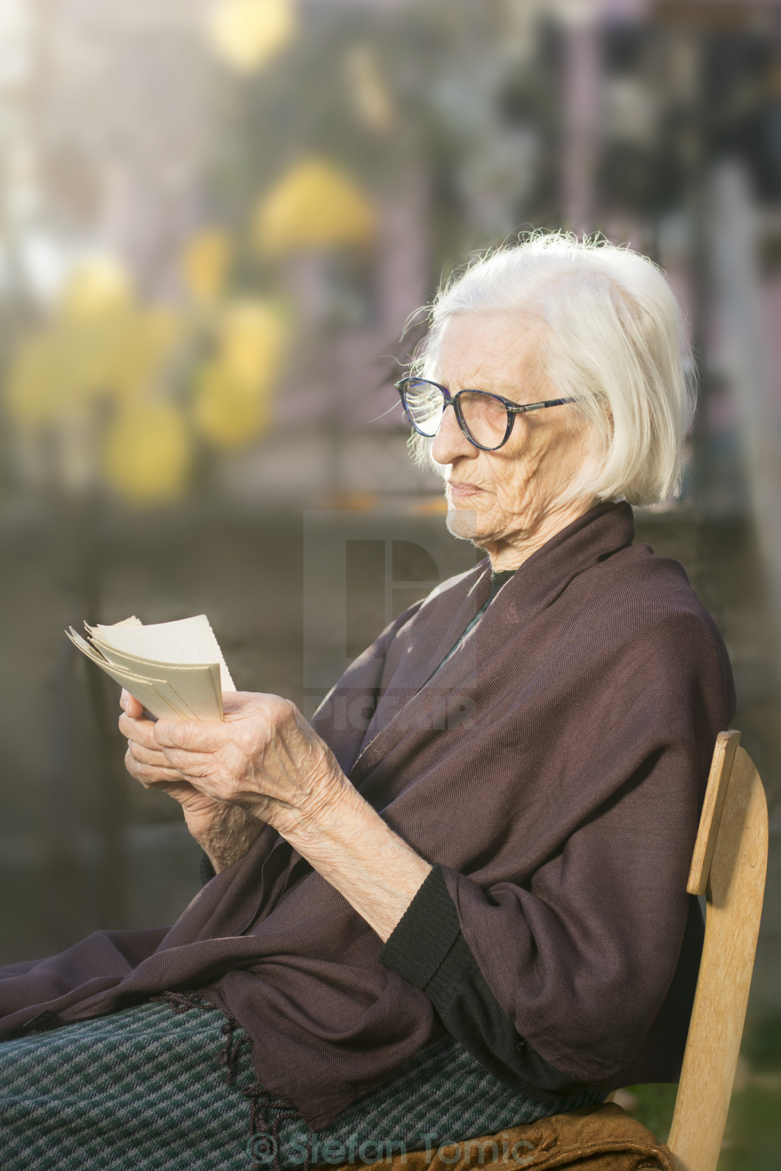 """Grandma looking at some very old photos"" stock image"