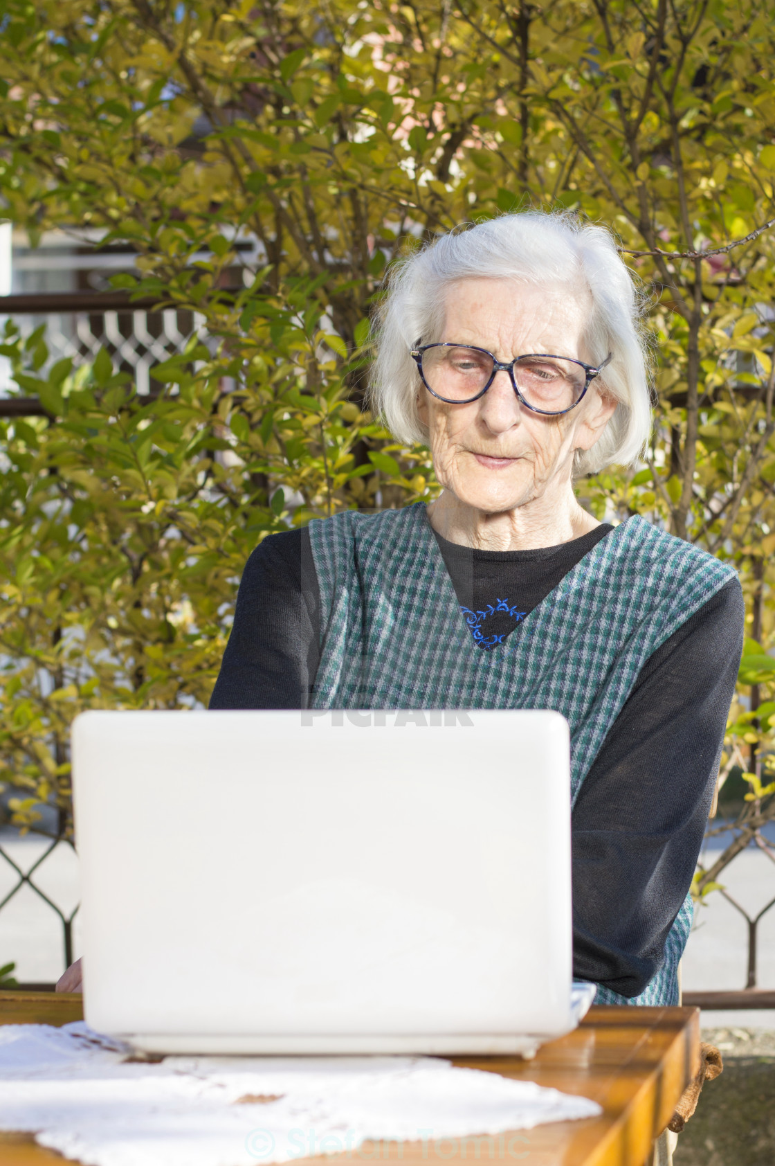 """90 years old woman having a video call"" stock image"