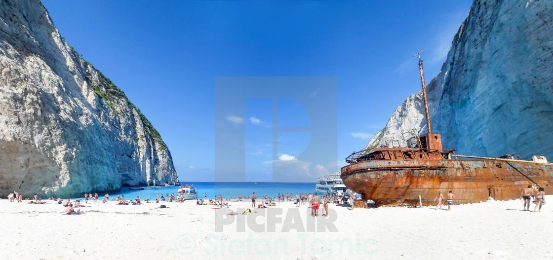 """Crowded Navagio Shipwreck beach, Zakynthos panorama"" stock image"