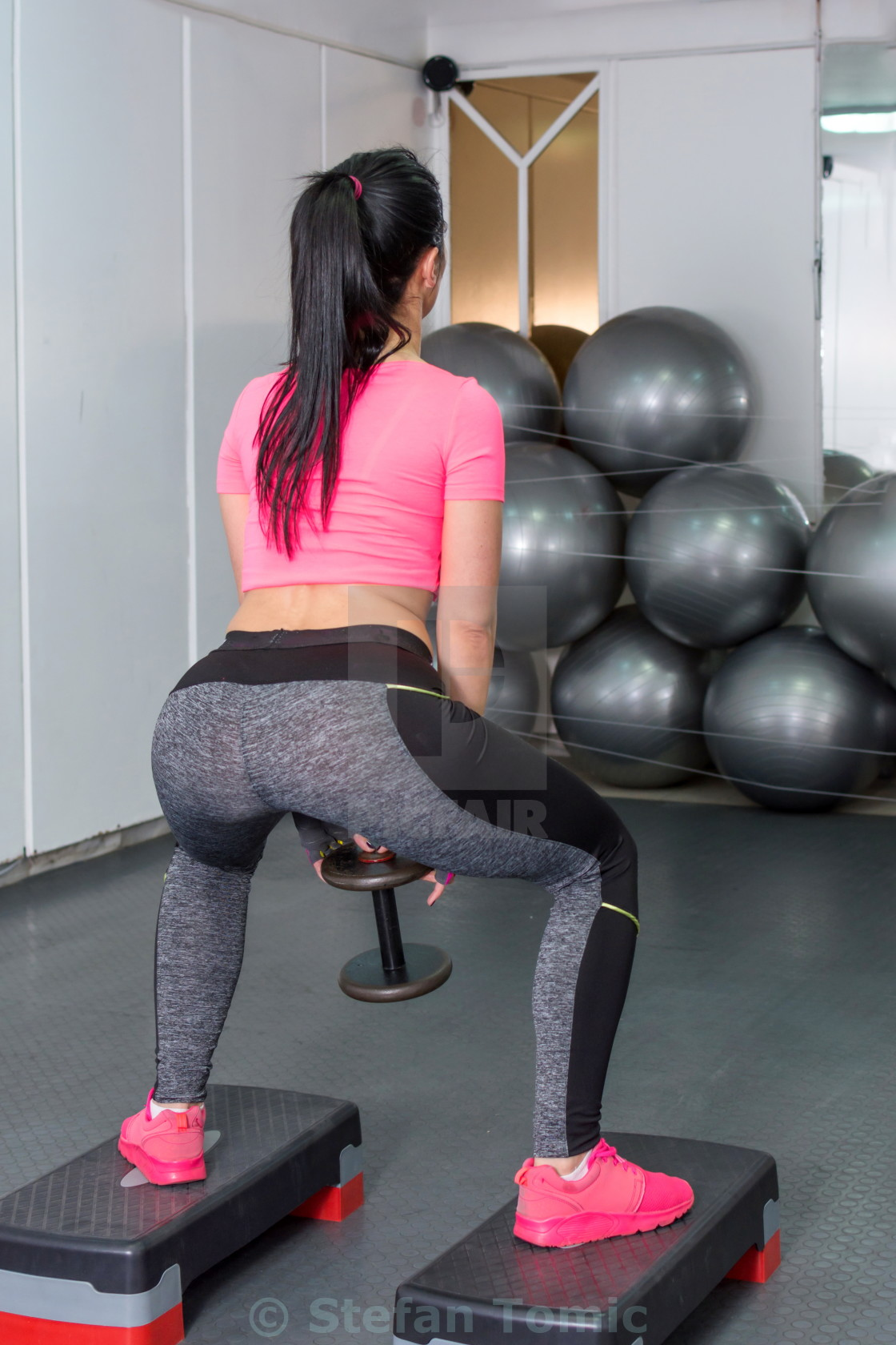 """girl doing squats with weights"" stock image"