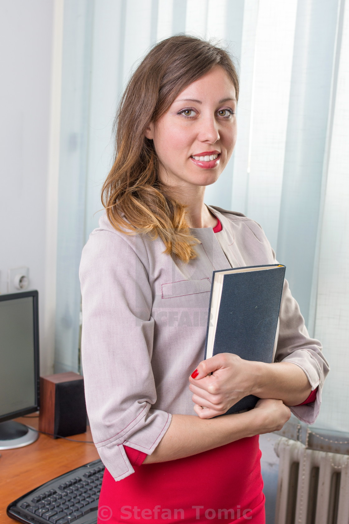 """Young businesswoman with notebook"" stock image"