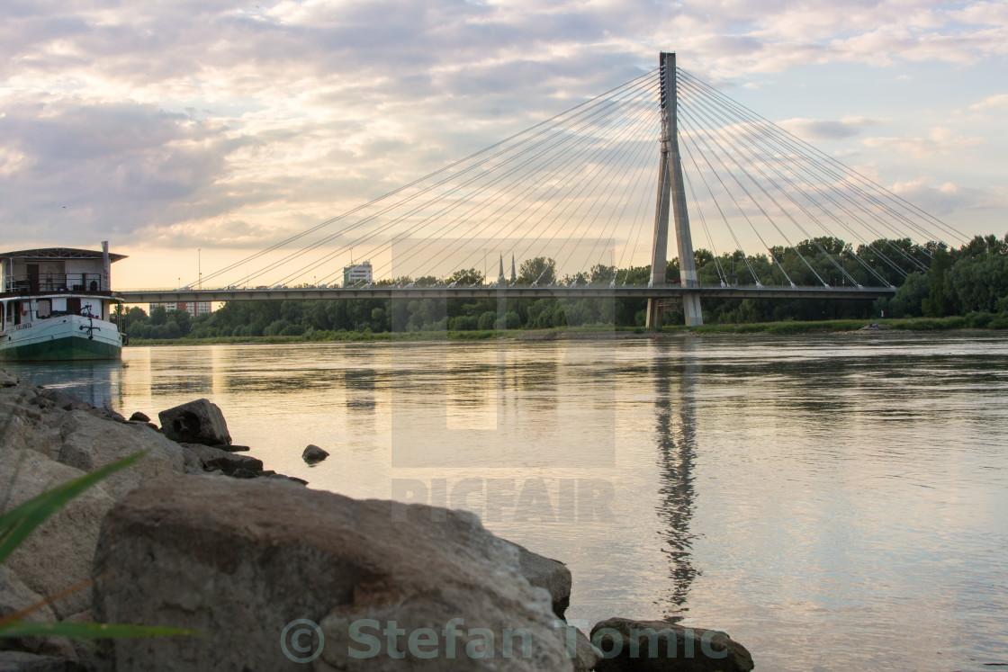 """Holy Cross Bridge over Vistula river in Warsaw Poland"" stock image"