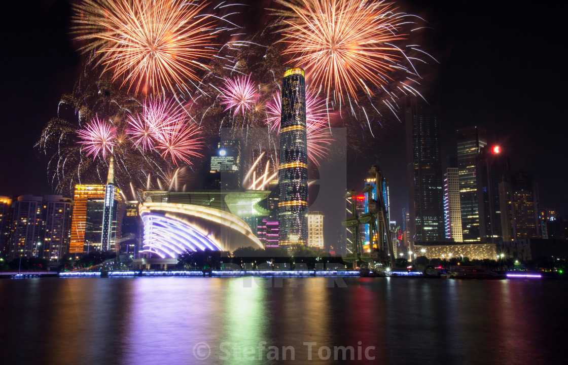 """Fireworks over Guangzhou city modern buildings China"" stock image"