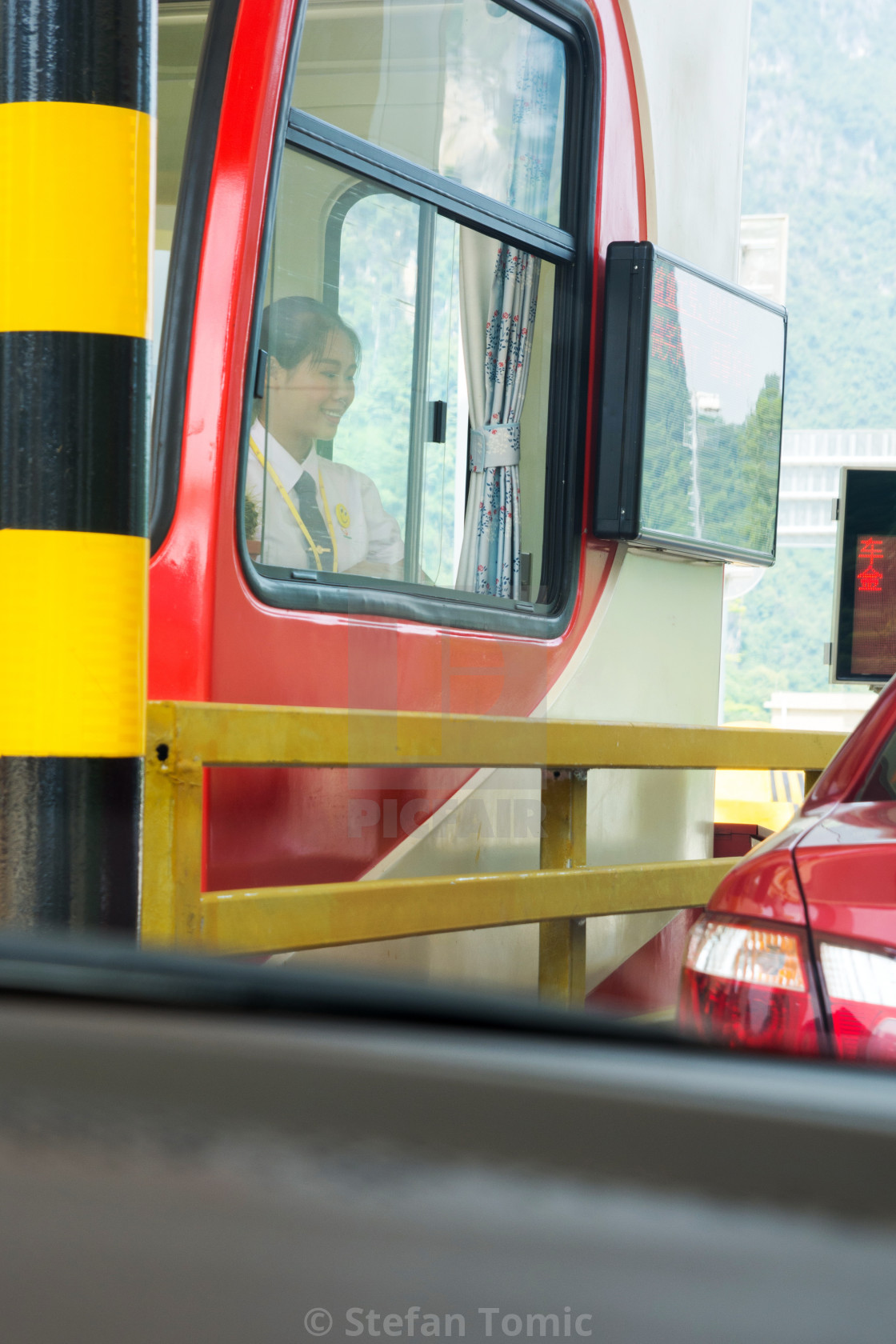 """""""Chinese girl charging toll on the highway"""" stock image"""