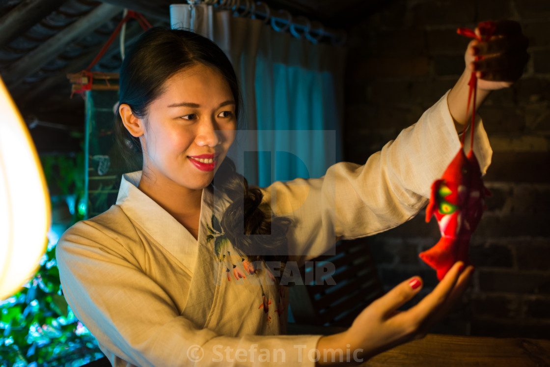 Chinese Girl Holding Good Luck Symbol License For 620 On Picfair