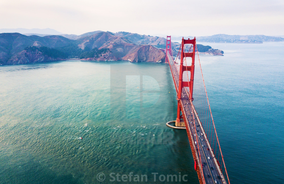 """Aerial view of Golden Gate bridge at sunset"" stock image"