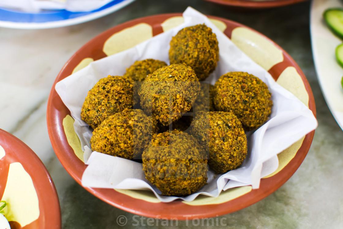 """Felafel balls in a rustic bowl"" stock image"