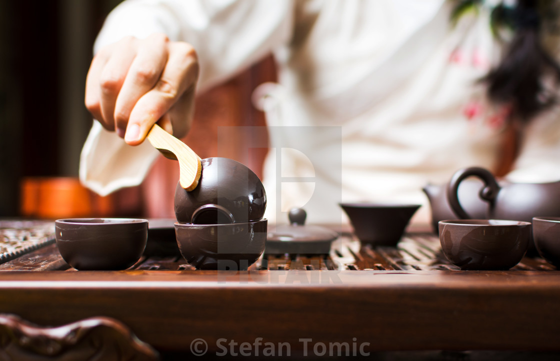 """""""Tea ceremony, woman cleaning teacup with boiled water"""" stock image"""