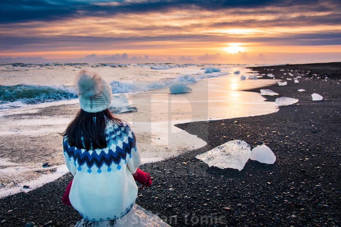 """Woman enjoying Diamond beach sunset in Iceland"" stock image"