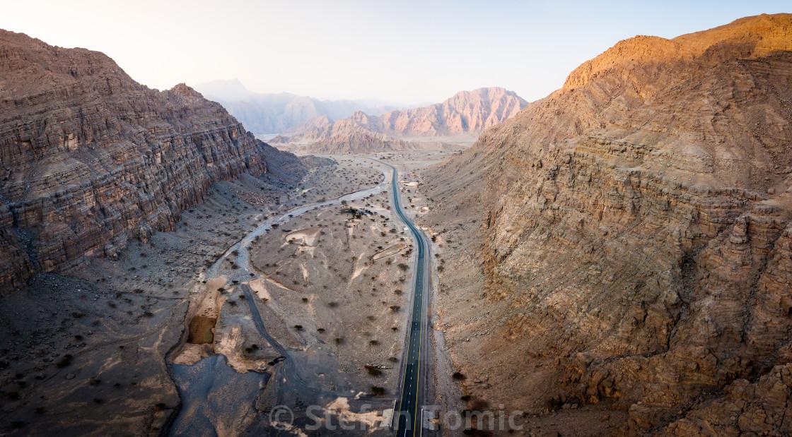 """Scenic desert road in the UAE aerial view"" stock image"