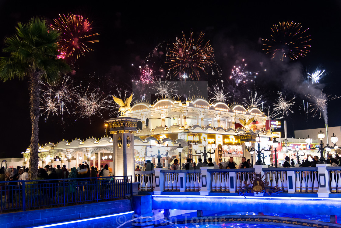 """""""People enjoying fireworks in Duabai Global village at one of the most visited tourist attractions in the United Arab Emirates at night"""" stock image"""