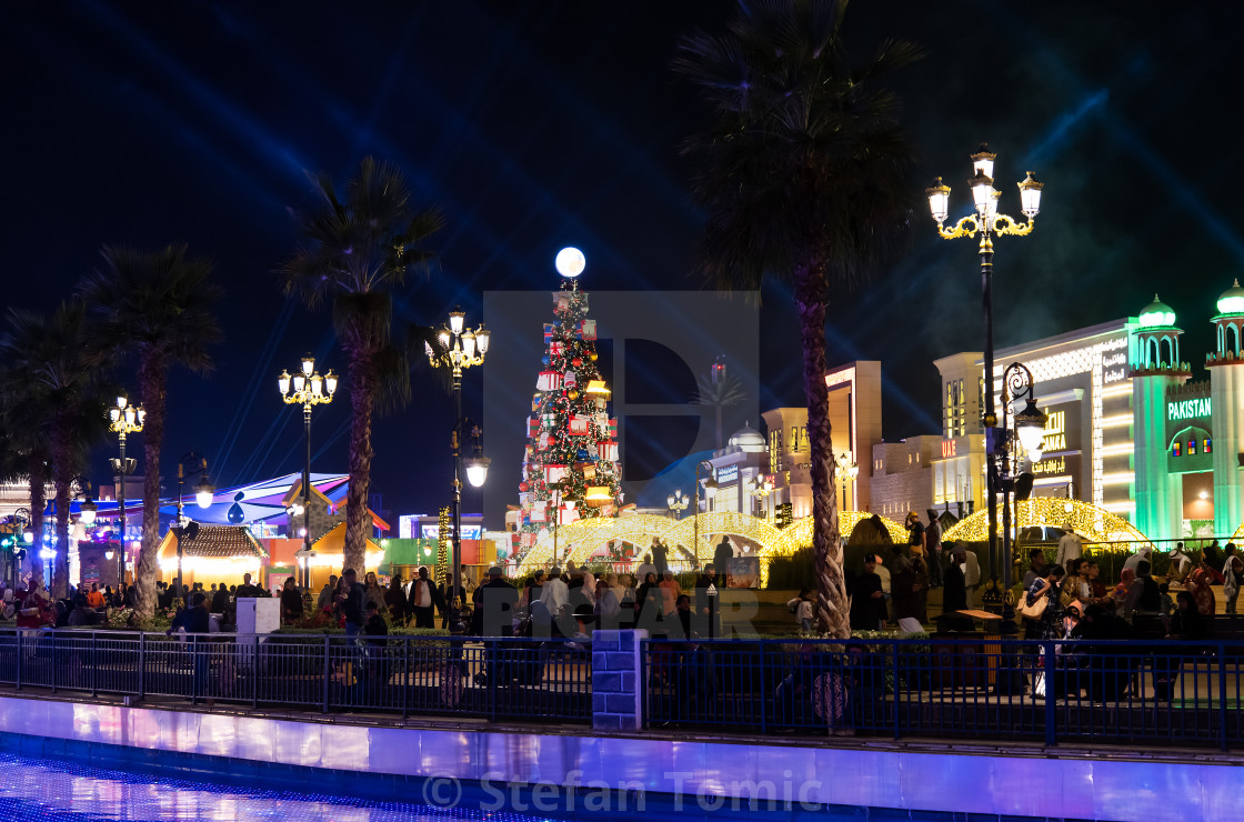"""Global village with big Christmas tree and winter holidays decorations in Dubai, UAE"" stock image"