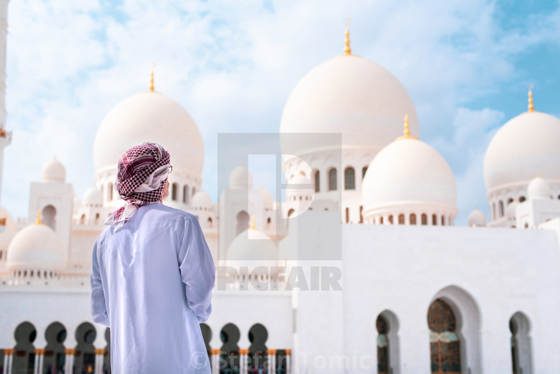 """Arab man visiting the Grand Mosque in Abu Dhabi"" stock image"