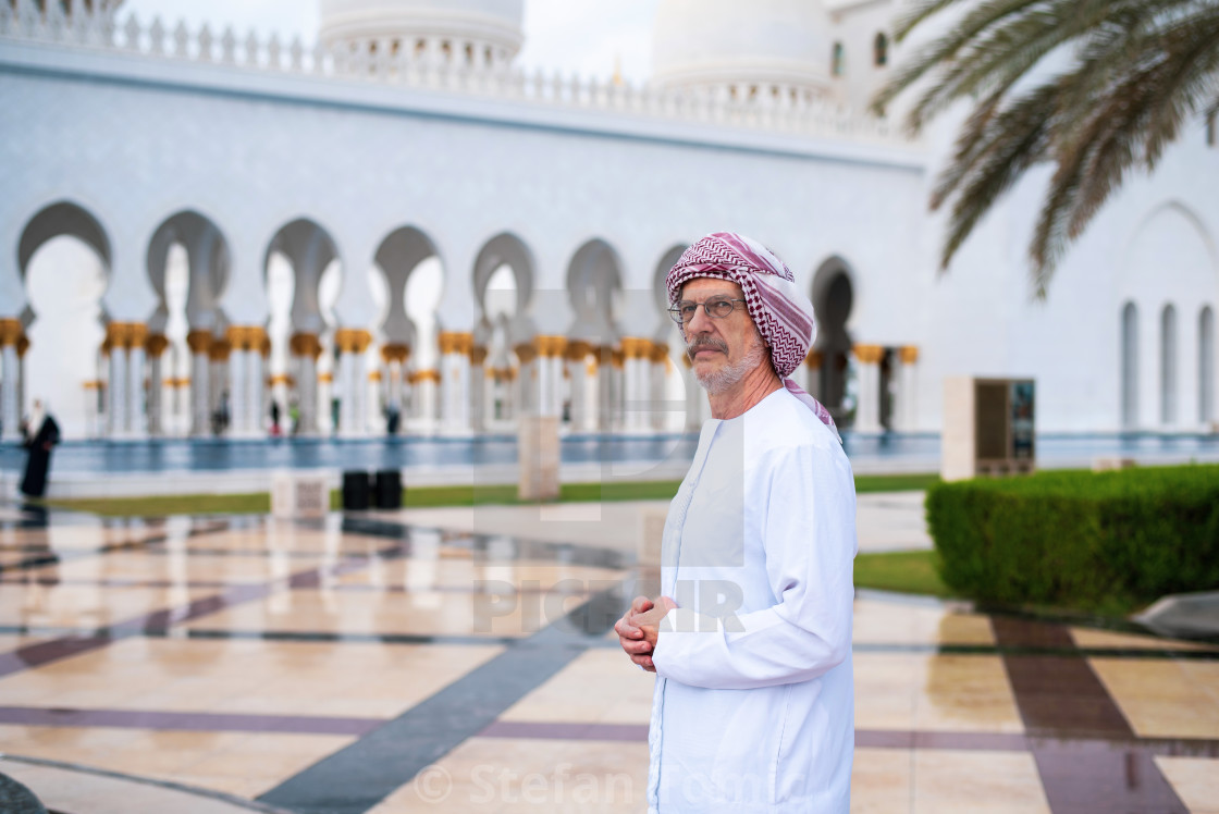 """""""Arab man visiting the Grand Mosque in Abu Dhabi"""" stock image"""