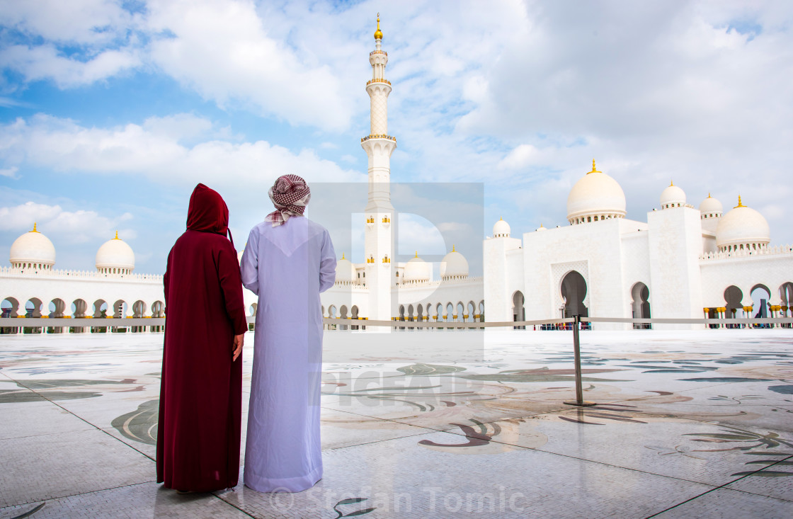 """Arab couple visiting the Grand Mosque in Abu Dhabi"" stock image"