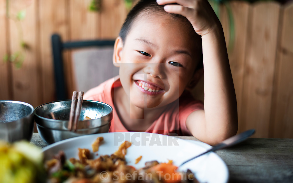 """Asian child having lunch at the restaurant"" stock image"