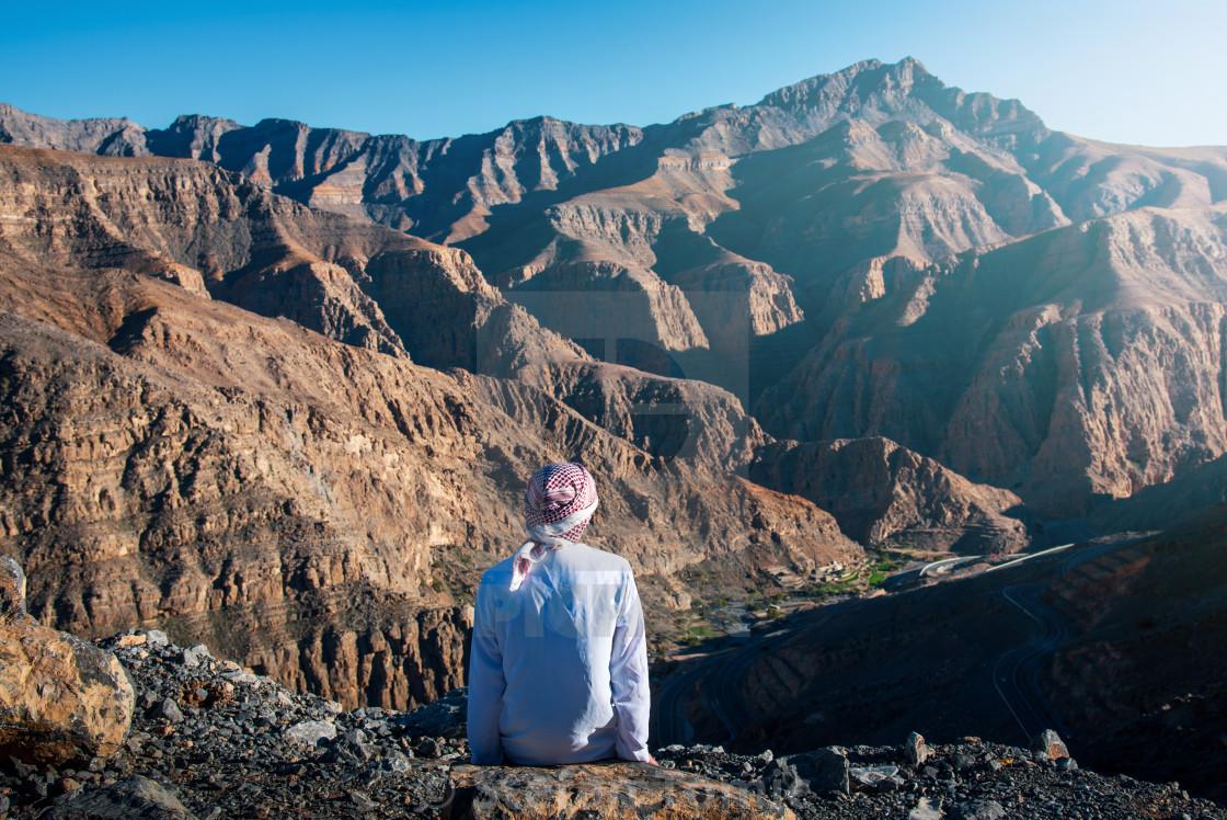 """""""Arab man enjoying Jais desert mountain view in UAE"""" stock image"""