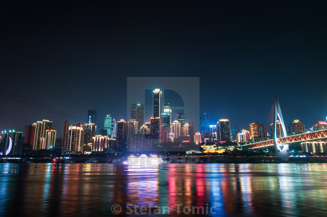 """Skyline view of Chongqing skyline rising over Yangtze river in China"" stock image"