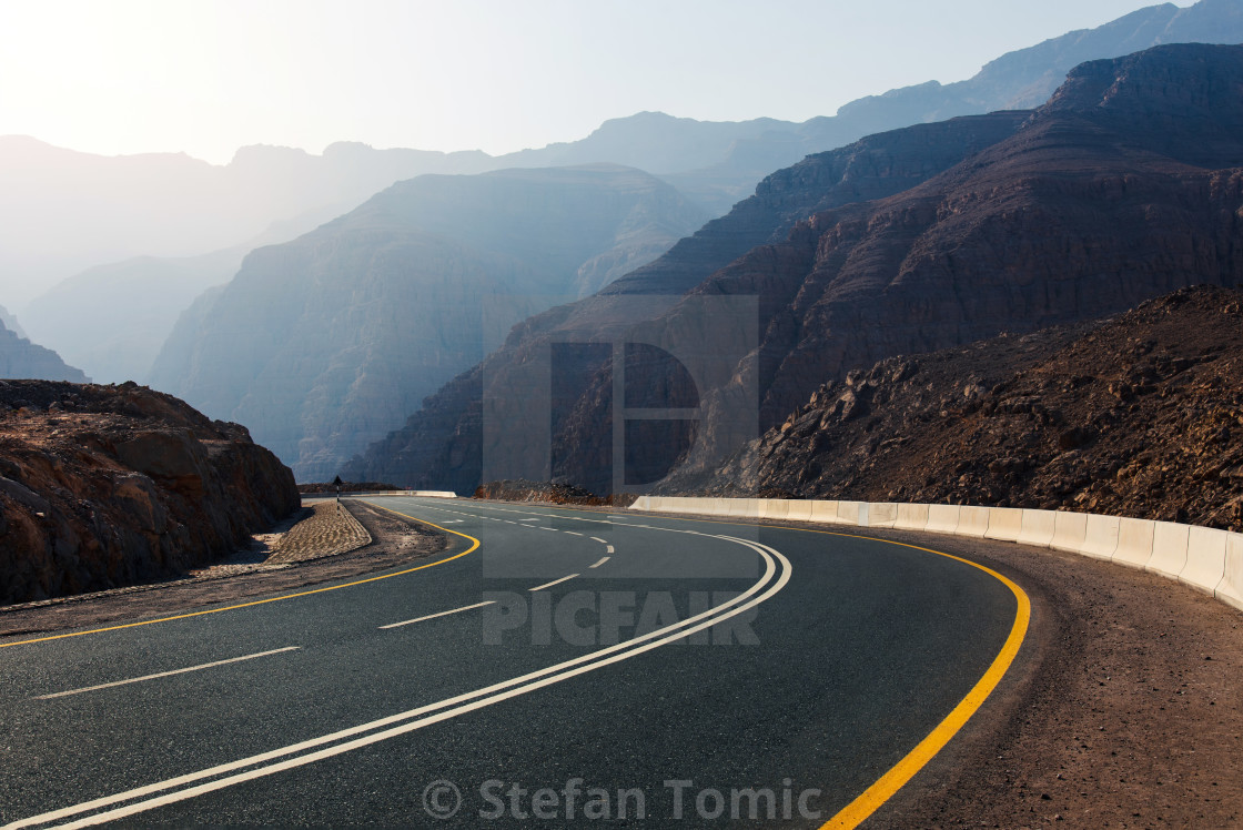 """Desert mountain road on Jais mountain in Ras al Khaimah, UAE"" stock image"