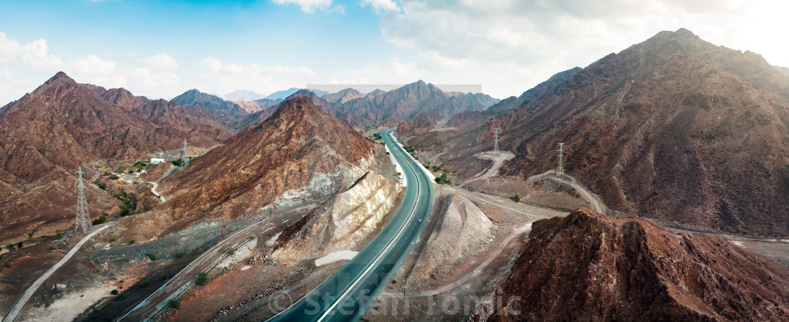 """Scenic road through Hajar mountain range stretching through UAE"" stock image"