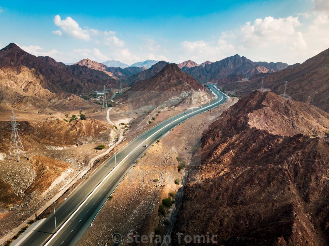 """Scenic road through Hajar mountain range stretching through UAE"" stock image"