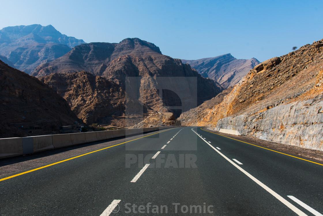 """Desert mountain road on Jais mountain in Ras al Khaimah, UAE"" stock image"