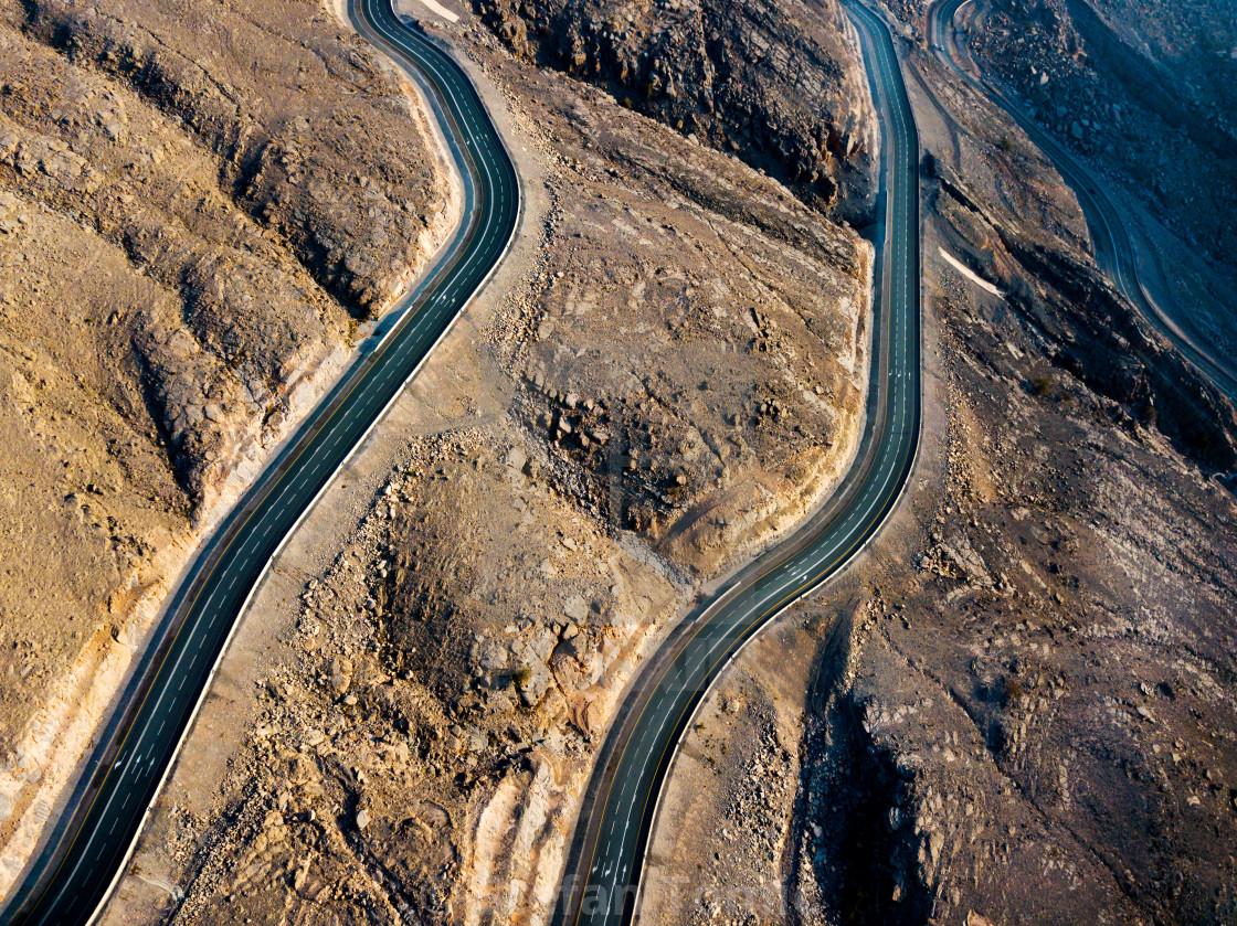 """Desert mountain road on the Jais mountain in UAE aerial view"" stock image"